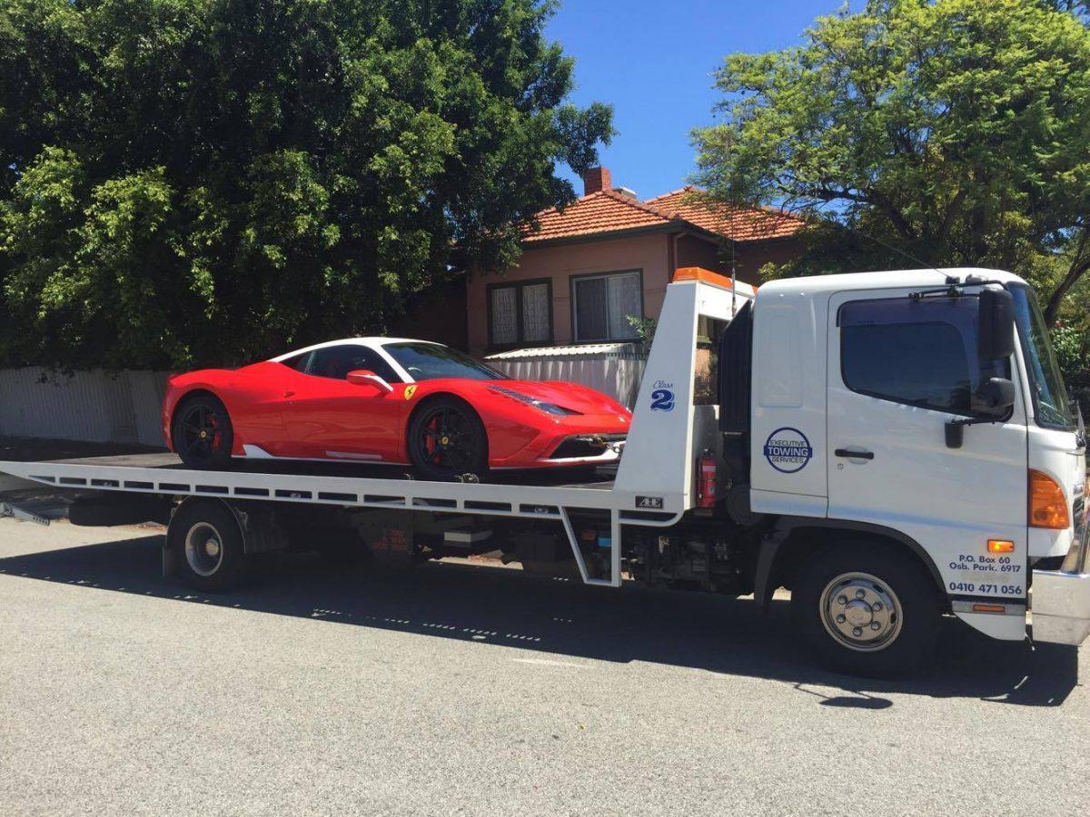 Tilt Tray Towing a Ferrari