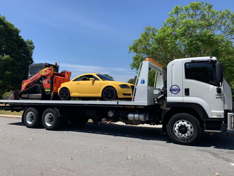 Tilt Tray with Vehicle and Machine Perth