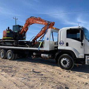 Tilt Tray Transporting a Excavator
